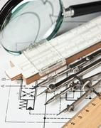 Engineering tools on technical drawing Stock Photos