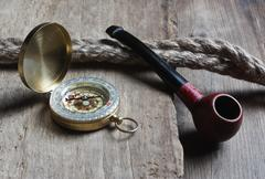 old tobacco pipe and compass - stock photo
