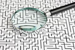 magnifying glass and labyrinth - stock photo