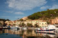 Stock Photo of boats at sunset, porto azzurro, elba island