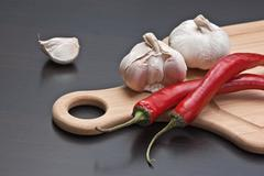 Garlic and red chili peppers Stock Photos
