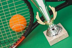 sports awards and  tennis racquets - stock photo