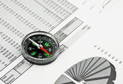 Compass and working paper Stock Photos