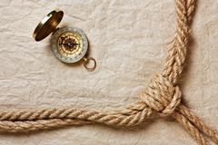 Compass, old paper and rope Stock Photos