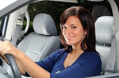 Young Woman Sat In The Drivers Seat Of Her Car Stock Photos