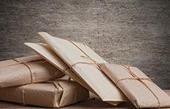 Pile parcels wrapped Stock Photos