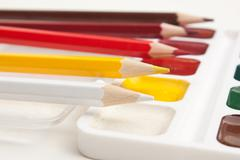 colored pencils and watercolor paints - stock photo