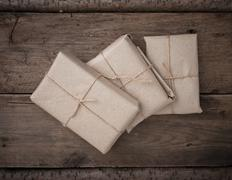 pile parcel wrapped - stock photo