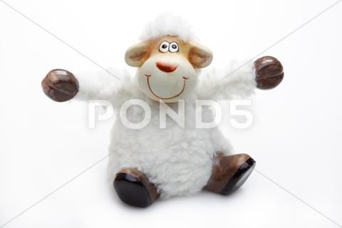 Stock photo of smiling sheep toy over white background
