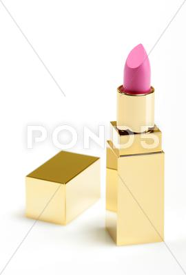 Stock photo of pink golden lipstick over white