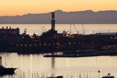 Port of genoa at sunset Stock Photos