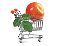fake apple in shopping carts - stock photo