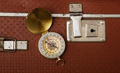 suitcase and compass - stock photo