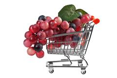 Bunch of grapes in shopping carts, fake Stock Photos
