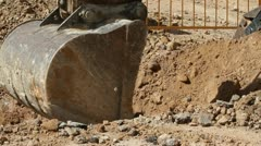 Excavator machine unloading sand at eathmoving works in construction site Stock Footage