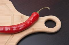 Stock Photo of red pepper on cutting board