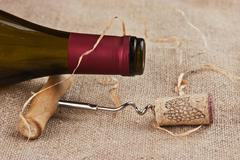 Stock Photo of wine bottle and corkscrew on a canvas