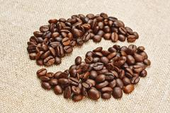 Coffee beans on a sack background Stock Photos