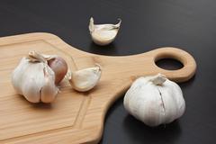 Stock Photo of garlic on  kitchen cutting board