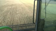 Stock Video Footage of harvester gathers the wheat on the field 4
