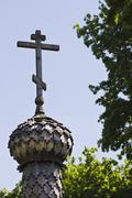 wooden orthodox cross on wooden cupola - stock photo