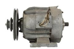 Old electric motor with a pulley (isolated) Stock Photos