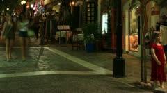Tourists crowded main shopping street, Agios Nikolaos, Crete Stock Footage