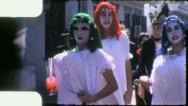 Stock Video Footage of Men Shake GIANT BOOBS Mardi Gras STREET SCENE 1959 Vintage Film Home Movie 4161