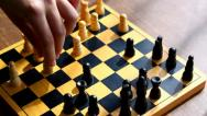 Playing chess, wooden chessboard on a table Stock Footage