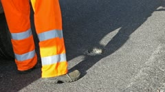 Road repairs: filling potholes in the asphalt. Stock Footage