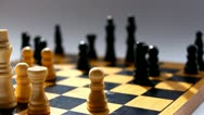Chess board on grey background closeup Stock Footage