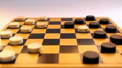 Playing checkers (draughts), capturing a piece - stock footage