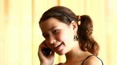 Young girl talking on a mobile phone, chatting - stock footage