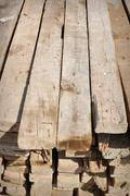 Lumber material to build home in poor country Stock Photos