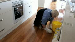 AUSTRALIA-CLEANING HOUSE-SCRUBBING FLOOR - stock footage