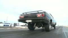 motorsports, drag racing, black Dodge Duster lanch, low angle - stock footage