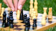 Close-up of playing chess outdoors, on grass Stock Footage