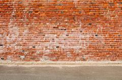 Old brick wall and road street Stock Photos