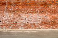 Stock Photo of old brick wall and road street