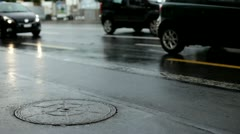 Cars driving by in wet weather Stock Footage