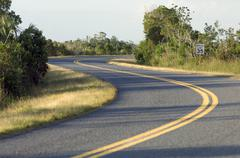 curving winding road 35 mph speed limit - stock photo