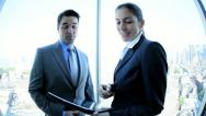 Handshake on business meeting Caucasian management team using tablet   Stock Footage