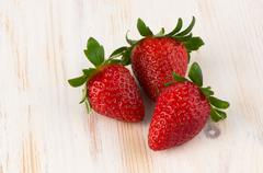 three fresh strawberries - stock photo