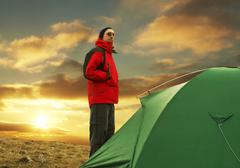 green tent on grassland in crimean mountain - stock photo