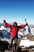 Climber on the peak Stock Photos