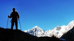 climber in snowy mountain - stock photo