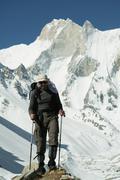 Climber going in himalayans mountain Stock Photos