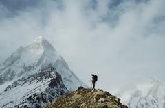 Climber going along morane in himalayan mountain Stock Photos