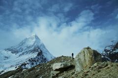 Climber on shivling peak background Stock Photos