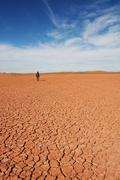 Stock Photo of man go up in sand desert